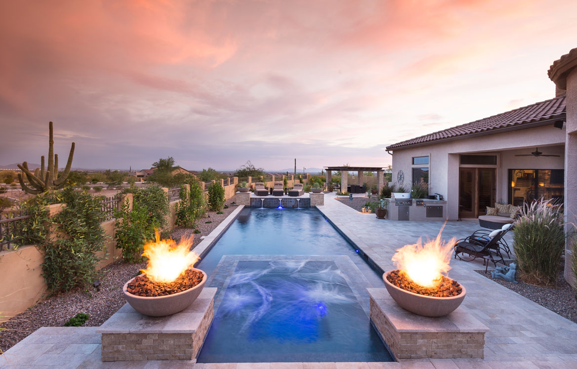 two rock burners next to a swimming pool
